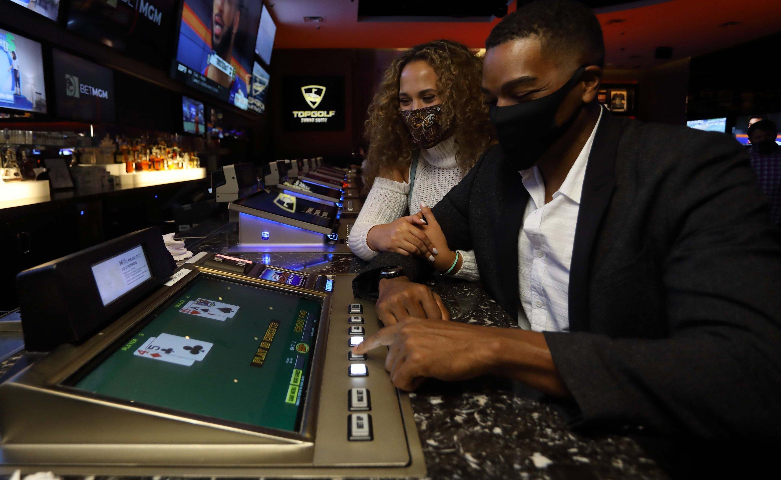 Man and Woman Gambling